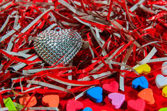 Silver heart, colorful small hearts  Valentines Day background Stock Photos
