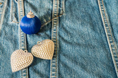 Silver heart decorated on jeans for background Stock Image