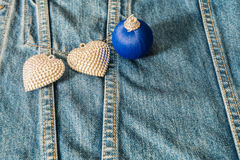 Silver heart decorated on jeans for background Royalty Free Stock Photography