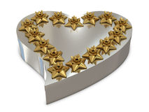 Silver heart gift box and golden flowers on the to Royalty Free Stock Photography