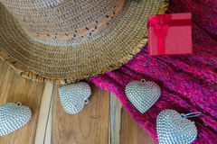 Silver heart, gift box,scarves, hat on wooden decorated Royalty Free Stock Images