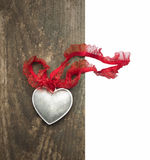 Silver heart,lace ribbon on old wood , isolated Royalty Free Stock Photography