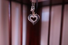 Hanging Silver Heart Bokeh royalty free stock images