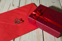 Silver heart pendant on a red envelope and gift box Stock Photo