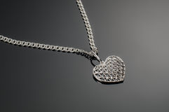 Silver heart pendant on silver chain Stock Image