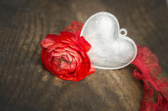 Silver heart and red rose on old wooden table,love Stock Image