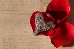 Silver heart with red roses Stock Photography