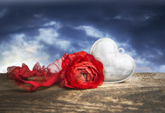 Silver heart and rose on wood and sky background Royalty Free Stock Photos