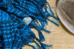 Silver heart, Scarf and hat on wooden Royalty Free Stock Photos