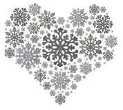 Silver heart shape from snowflakes on white Stock Photos