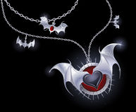 Silver heart of a vampire Stock Photography