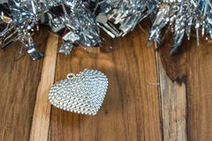 Silver heart on the wooden floor Royalty Free Stock Photo