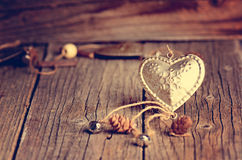 Silver heart on a wooden table with decorations. Valentines day. Love. Gift. Ilustration on a natural background. Royalty Free Stock Photography