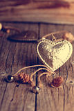 Silver heart on a wooden table with decorations. Valentines day. Love. Gift. Ilustration on a natural background. Silver heart on a wooden table with Stock Image