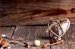 Silver heart on a wooden table with decorations. Valentines day. Love. Gift. Ilustration on a natural background. Royalty Free Stock Photo