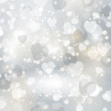 Silver hearts background Stock Photos