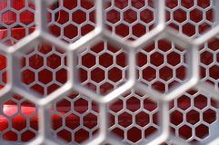 Silver Hexagon Shapes With Red. Hexagon Shapes Within Hexagon Shapes or Red and Silver Honeycomb Object Stock Image