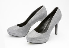 Silver high heeled party shoes. Stock Image