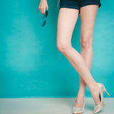 Silver high heels fashionable shoes on sexy female legs Royalty Free Stock Images