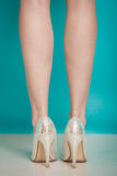 Silver high heels fashionable shoes on sexy female legs Stock Photos