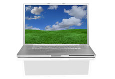 Silver Hip Laptop Computer With Beautiful Desktop Royalty Free Stock Photos