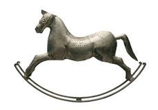 Silver horse. An antique toy. The rocking-horse stock photo