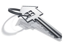 Silver house-shape key Royalty Free Stock Images