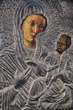 Silver Icon of Mary and Jesus. A silver Icon of Mary holding Baby Jesus Royalty Free Stock Images