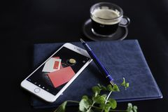 Silver Iphone 6 With Blue Click-pen stock photography