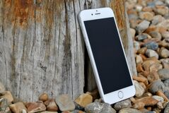 Silver Iphone 6 on Gray and Brown Stone Stock Photography