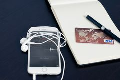 Silver Iphone 6 Beside Red Visa Card Royalty Free Stock Images