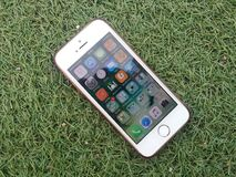 Silver Iphone on a Green Grass Stock Photography