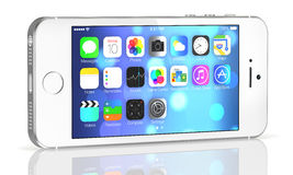 Silver iPhone 5s. Showing the home screen with iOS7. Some of the new features of the iPhone 5s include fingerprint recognition built into the home button, a new Royalty Free Stock Image