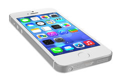 Silver iPhone 5s. Showing the home screen with iOS7. Some of the new features of the iPhone 5s include fingerprint recognition built into the home button, a new Stock Photography