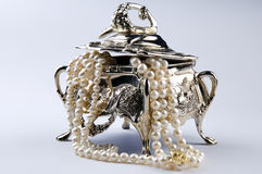 Silver jewelery box with pearls. Photo of silver jewelery box isolated Stock Image