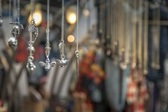 Silver Jewellery hanging on a market stall stock photo
