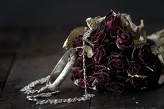 Silver jewelry. With bunch of roses Royalty Free Stock Photography