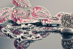 Silver jewelry on the background of a jewellery with pink stones Stock Image