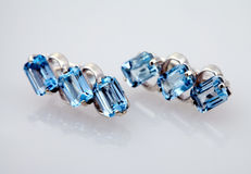Silver jewelry with blue topaz Royalty Free Stock Photo
