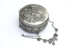 Silver jewelry box with a neckless. Isolated on white background Royalty Free Stock Photo
