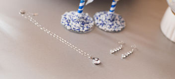 Silver jewelry chain with pendant and earrings Stock Photos