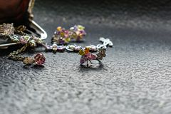 Silver jewelry with colored stones-cubic Zirconia of different colors, delicate shades. Jewelry pink, green, yellow and lilac. Rhi. Nestones on metal products stock photo