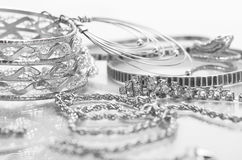 Silver jewelry. Different silver jewelry on the table Stock Images