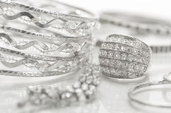 Silver jewelry. Different silver jewelry on the table Stock Photos