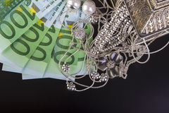 Silver jewelry and euro Royalty Free Stock Photography