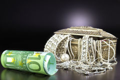 Silver jewelry and Euro Stock Photo