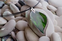 Silver jewelry in the form of a leaf stock photos