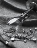 Silver jewelry and goblet Stock Photography