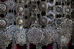 Silver jewelry in the market. Closeup shiny glamour silver jewelry Stock Photo