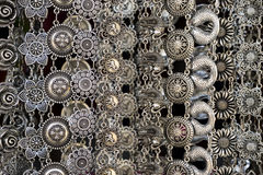 Silver jewelry in the market. Closeup shiny glamour silver jewelry Royalty Free Stock Image